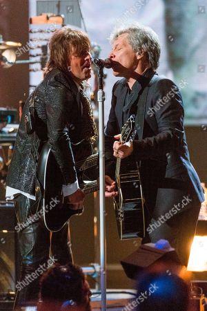 Richie Sambora, Jon Bon Jovi. Richie Sambora, left, and Jon Bon Jovi perform together at the 2018 Rock and Roll Hall of Fame induction ceremony at Cleveland Public Auditorium, in Cleveland, Ohio