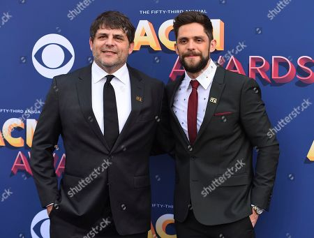 Thomas Rhett, Rhett Akins. Rhett Akins and Thomas Rhett arrive at the 53rd annual Academy of Country Music Awards at the MGM Grand Garden Arena, in Las Vegas
