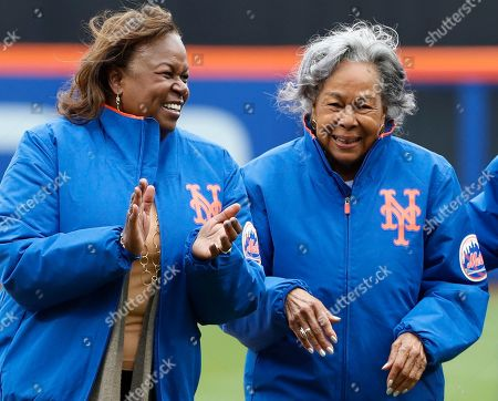Sharon Robinson, Rachel Robinson. Jackie Robinson's daughter Sharon, left, and widow Rachel, applaud after the ceremonial first pitch was thrown out in a baseball game, in New York
