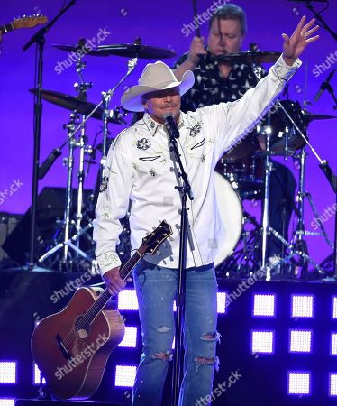 Alan Jackson waves to the crowd during a performance at the 53rd annual Academy of Country Music Awards at the MGM Grand Garden Arena, in Las Vegas