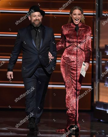 Kristian Bush, Jennifer Nettles. Kristian Bush, left, and Jennifer Nettles, of Sugarland, walk on stage to present the award for album of the year at the 53rd annual Academy of Country Music Awards at the MGM Grand Garden Arena, in Las Vegas