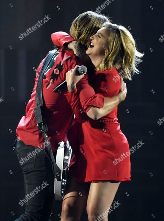 """Keith Urban, Julia Michaels. Keith Urban, left, and Julia Michaels hug after performing """"Coming Home"""" at the 53rd annual Academy of Country Music Awards at the MGM Grand Garden Arena, in Las Vegas"""
