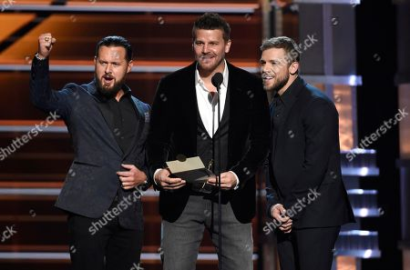 Stock Image of A.J. Buckley, David Boreanaz, Max Thieriot. A.J. Buckley, from left, David Boreanaz, and Max Thieriot present the award for vocal group of the year at the 53rd annual Academy of Country Music Awards at the MGM Grand Garden Arena, in Las Vegas