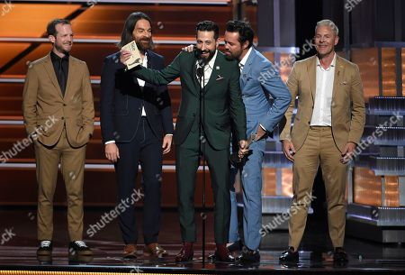 Whit Sellers, Geoff Sprung, Matthew Ramsey, Brad Tursi, Trevor Rosen. Whit Sellers, from left, Geoff Sprung, Matthew Ramsey, Brad Tursi and Trevor Rosen, of Old Dominion, accept the award for vocal group of the year at the 53rd annual Academy of Country Music Awards at the MGM Grand Garden Arena, in Las Vegas