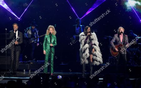 """Jimi Westbrook, Kimberly Schlapman, Karen Fairchild, Philip Sweet. Jimi Westbrook, from left, Kimberly Schlapman, Karen Fairchild and Philip Sweet, of Little Big Town, perform """"Rocket Man"""" at the 53rd annual Academy of Country Music Awards at the MGM Grand Garden Arena, in Las Vegas"""