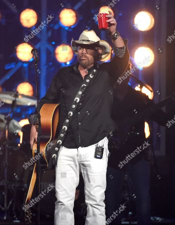 """Toby Keith raises a red cup after performing """"Should've Been a Cowboy"""" at the 53rd annual Academy of Country Music Awards at the MGM Grand Garden Arena, in Las Vegas"""