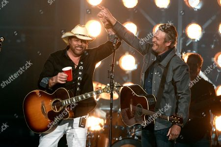 """Toby Keith, Blake Shelton. Toby Keith, left, and Blake Shelton perform """"Should've Been a Cowboy"""" at the 53rd annual Academy of Country Music Awards at the MGM Grand Garden Arena, in Las Vegas"""