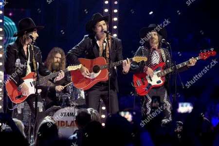 """Jess Carson, Mark Wystrach, Cameron Duddy. Jess Carson, from left, Mark Wystrach and Cameron Duddy, of Midland, perform """"Drinkin' Problem"""" at the 53rd annual Academy of Country Music Awards at the MGM Grand Garden Arena, in Las Vegas"""