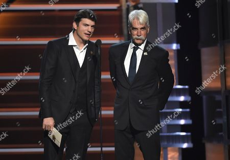 Ashton Kutcher, Sam Elliott. Ashton Kutcher, left, and Sam Elliott present the award for vocal event of the year at the 53rd annual Academy of Country Music Awards at the MGM Grand Garden Arena, in Las Vegas