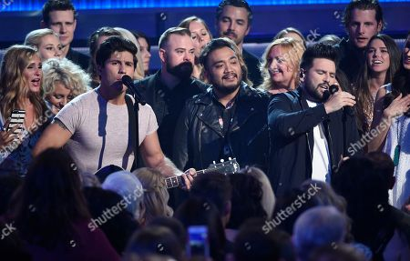 """Dan Smyers, Shay Mooney. Dan Smyers, left and Shay Mooney, of Dan+Shay, perform """"Tequila"""" in the audience at the 53rd annual Academy of Country Music Awards at the MGM Grand Garden Arena, in Las Vegas"""