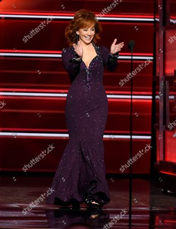 Host Reba McEntire walks on stage at the 53rd annual Academy of Country Music Awards at the MGM Grand Garden Arena, in Las Vegas