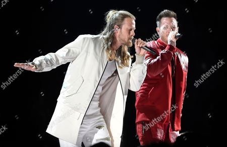 """Tyler Hubbard, Brian Kelley. Tyler Hubbard, right, and Brian Kelley, of Florida Georgia Line, perform """"Meant to Be"""" at the 53rd annual Academy of Country Music Awards at the MGM Grand Garden Arena, in Las Vegas"""