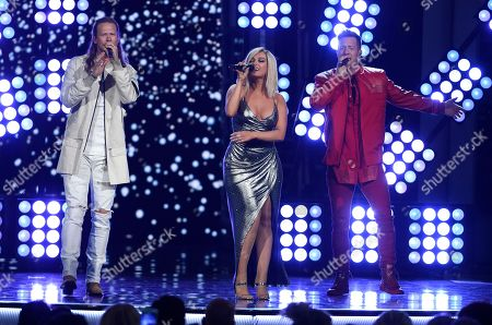 """Tyler Hubbard, Brian Kelley, Bebe Rexha. Tyler Hubbard, right, and Brian Kelley, left, of Florida Georgia Line, and Bebe Rexha, center, perform """"Meant to Be"""" at the 53rd annual Academy of Country Music Awards at the MGM Grand Garden Arena, in Las Vegas"""