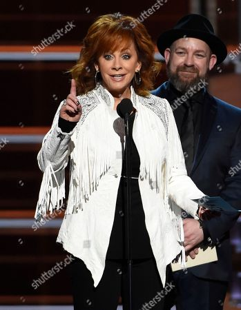 """Reba McEntire, Kristian Bush, Jennifer Nettles. Reba McEntire, accepts the award for album of the year for """"From A Room: Volume 1"""" on behalf of Chris Stapleton at the 53rd annual Academy of Country Music Awards at the MGM Grand Garden Arena, in Las Vegas. Looking on is presenter Kristian Bush of Sugarland"""
