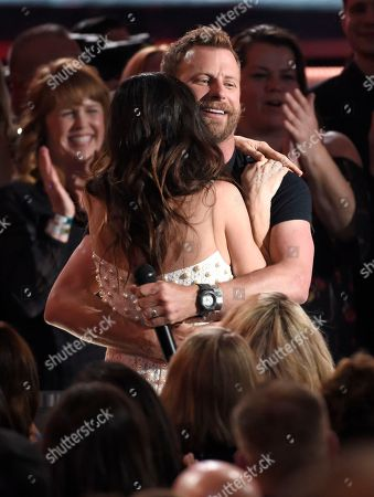 """Dierks Bentley, Cassidy Black. Dierks Bentley, right, hugs Cassidy Black in the audience while performing """"Woman, Amen"""" at the 53rd annual Academy of Country Music Awards at the MGM Grand Garden Arena, in Las Vegas"""