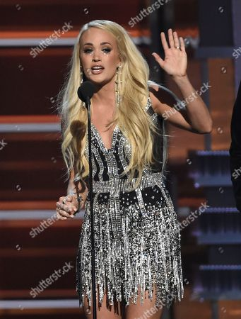 """Carrie Underwood accepts the award for vocal event of the year for """"The Fighter"""" at the 53rd annual Academy of Country Music Awards at the MGM Grand Garden Arena, in Las Vegas"""