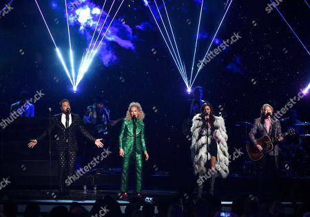"""Jimi Westbrook, Kimberly Schlapman,Philip Sweet, Karen Fairchild. Jimi Westbrook, from left, Kimberly Schlapman, Karen Fairchild and Philip Sweet, of Little Big Town, perform """"Rocket Man"""" at the 53rd annual Academy of Country Music Awards at the MGM Grand Garden Arena, in Las Vegas"""