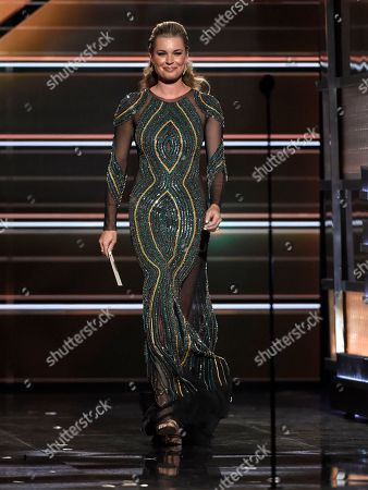 Rebecca Romijn appear on stage to present the award for male vocalist of the year at the 53rd annual Academy of Country Music Awards at the MGM Grand Garden Arena, in Las Vegas