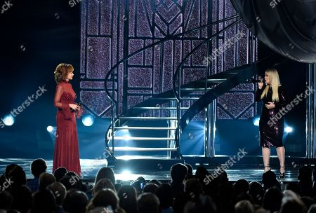 """Kelly Clarkson, Reba McEntire. Kelly Clarkson, left, and Reba McEntire perform """"Does He Love You"""" at the 53rd annual Academy of Country Music Awards at the MGM Grand Garden Arena, in Las Vegas"""