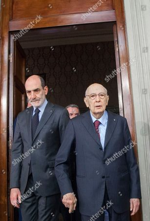 Giorgio Napolitano, Italy's former president, center, arrives to speak at a news conference following a meeting with the Italian President