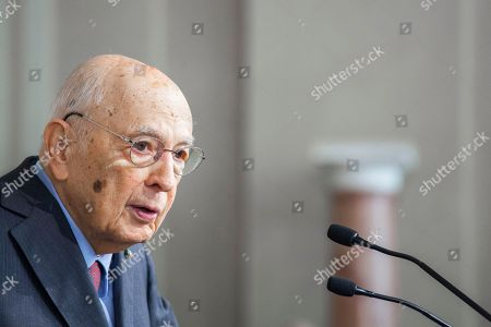 Stock Image of Giorgio Napolitano, Italy's former president, center, arrives to speak at a news conference following a meeting with the Italian President
