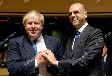 British Foreign Secretary Boris Johnson, left, speaks with Italian Foreign Minister Angelino Alfano during a meeting of EU foreign ministers at the EU Council building in Luxembourg on