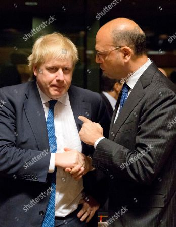 British Foreign Secretary Boris Johnson, left, speaks with Italian Foreign Minister Angelino Alfano, right, during a meeting of EU foreign ministers at the EU Council building in Luxembourg on