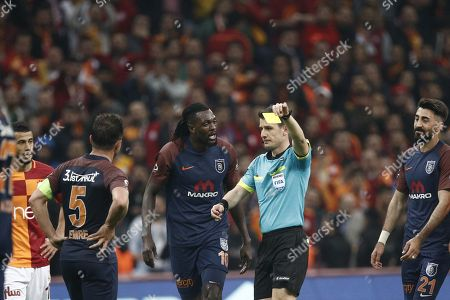 Emmanuel Adebayor of Basaksehir reacts to the referee for a yellow card given to a teammate