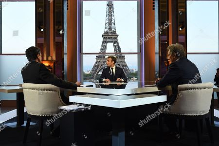 Stock Picture of French President Emmanuel Macron poses on the TV set before an interview with RMC-BFM French journalist Jean-Jacques Bourdin and Mediapart investigative website French journalist Edwy Plenel