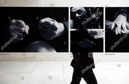 A visitor walks past some photos of the Literature Nobel Prize laureates (L-R) Patrick Modiano, Jose Saramago and Nadie Gordimer during the presentation of the 96 photos of 23 Literature Nobel Prize laureates at CaixaForum foundation in Barcelona, northeastern Spain, 16 April 2018. Manresa took photos for several Ayen's interviews of the Nobel laureates. The exhibition runs from 16 April to 02 September 2018.