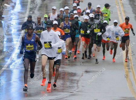 Stock Picture of Evans Chebet, Arne Gabius. Evans Chebet, left, of Kenya, and Arne Gabius (15), of Germany, lead the men's elite field of runners during the second mile of the 122nd Boston Marathon, in Hopkinton, Mass