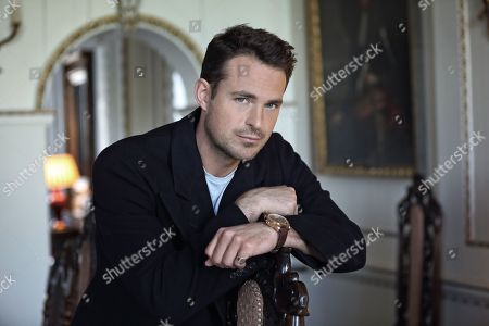 Jules Knight leaning on chair in dining room at Raynham Hall, Norfolk