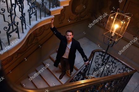 Jules Knight in low light at Raynham Hall on William Kett staircase