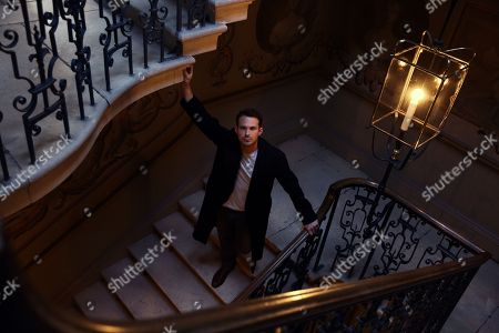 Stock Image of Jules Knight in low light at Raynham Hall on William Kett staircase