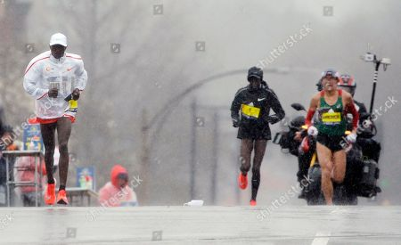 Stock Picture of Yuki Kawauchi, Geoffrey Kirui, Edna Kiplagat. Yuki Kawauchi, right, of Japan, overtakes leader Geoffrey Kirui, left, of Kenya, after passing Edna Kiplagat, a women's runner also of Kenya, as he takes the lead in the 122nd Boston Marathon, in Boston. He is the first Japanese man to win the race since 1987