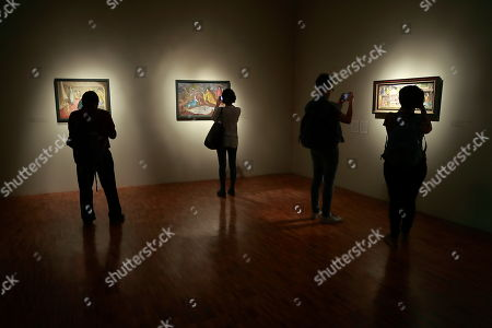 People view paintings during the 'Leonora Carrington. Magic Tales' exhibition at the Modern Art Museum, in Mexico City, Mexico, 16 April 2018. British-born Mexican artist, surrealist painter, and novelist Leonora Carrington died on 25 May 2011.