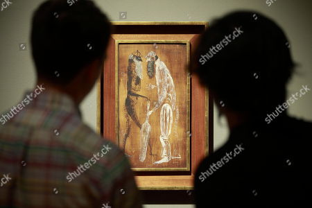 Stock Picture of People view a painting during the 'Leonora Carrington. Magic Tales' exhibition at the Modern Art Museum, in Mexico City, Mexico, 16 April 2018. British-born Mexican artist, surrealist painter, and novelist Leonora Carrington died on 25 May 2011.