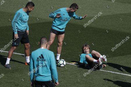 Real Madrid's players Brazilian midfielder Carlos Henrique Casimiro (L), French striker Karim Benzema (2-L), Portuguese striker Cristiano Ronaldo (2-R) and Croatian midfielder Luka Modric (R) during a team's training session at Valdebebas sports city in Madrid, Spain, 17 April 2018. Real Madrid will face Athletic Bilbao in a Spanish Primera Division soccer match on 18 April.