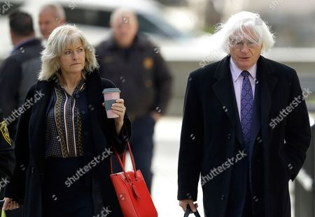 Attorneys Kathleen Bliss, left, and Tom Mesereau arrive for Bill Cosby's sexual assault trial, at the Montgomery County Courthouse in Norristown, Pa
