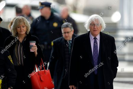 Attorneys Tom Mesereau, right, Kathleen Bliss arrive for Bill Cosby's sexual assault trial, at the Montgomery County Courthouse in Norristown, Pa