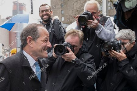 Former New York Gov. Eliot Spitzer, left, walks past photographers assembled outside federal court for a hearing for Michael Cohen, President Donald Trump's personal attorney, in New York. Spitzer was in court on an unrelated matter