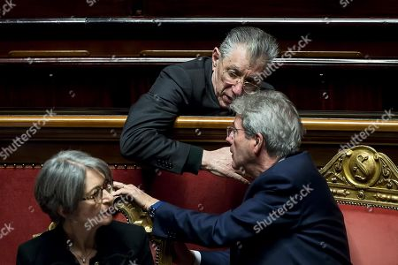Stock Photo of Italian Prime Miinister Paolo Gentiloni (R) talks with Umberto Bossi (C) and Anna Finocchiaro (L) at the end of his speech at the Chamber of Deputies about Syria's situation, in Rome, Italy, 17 April 2018. Gentiloni condemned the use of chemical weapons in connection to the latest suspected poison gas attack in Douma, Syria, that took place on 07 April 2018.