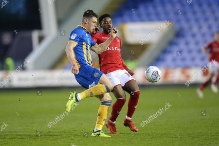 13 James Bolton for Shrewsbury Town and 14 Tarique Fosu-Henry for Charlton Athletic during the EFL Sky Bet League 1 match between Shrewsbury Town and Charlton Athletic at Greenhous Meadow, Shrewsbury. Picture by Graham Holt