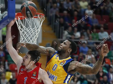 Nando de Colo (L) of CSKA Moscow in action against Thomas Robinson (R) of Khimki Moscow during the Euroleague basketball Playoff game 2 between CSKA Moscow and Khimki Moscow, in Moscow, Russia, 17 April 2018.