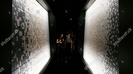 Stock Image of Visitors watch the installation of the Nendo studios of designer Oki Sato during the first day of the Design Week, in Milan, Italy, . The Milan Design week is taking place in various locations across Milan from April 17 through 22, 2018