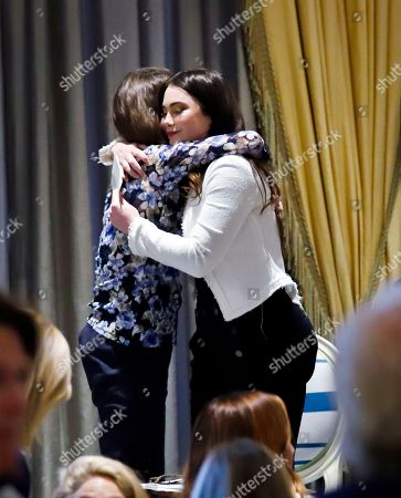 Olympic gold medal gymnast McKayla Maroney, right, embraces Dr. Mary Pulido, left, executive director of The New York Society for the Prevention of Cruelty to Children (NYSPCC), after speaking at 2018 Spring fundraising luncheon for NYSPCC, in New York. It was Maroney's first public remarks since her testimony as a sexual abuse victim of U.S. women's gymnastics team doctor Larry Nassar