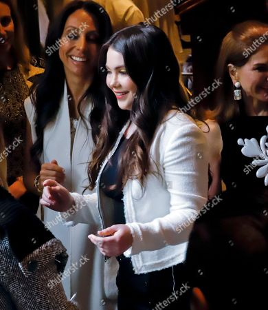 Olympic gold medal gymnast McKayla Maroney, center, a sexual abuse victim of U.S. women's gymnastics team doctor Larry Nassar, arrives to make her first public remarks as the featured speaker at the 2018 Spring luncheon of The New York Society for the Prevention of Cruelty to Children (NYSPCC), in New York