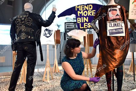 (L) Katherine Hamnett 'Clean Up or Die' man's ensemble, 1989. (Background middle) Bridget Harvey 'Mend More' Jumper, 2015. (R) Vivian Westwood dress, sleeves and stockings, 2012. Vivian Westwood 'Ecotricity crown', 2017. Vivian Westwood 'Climate Revolution' shoes, 2013. Vivian Westwood 'Save the Arctic' T-shirt, 2015. Vivian Westwood Archive 'Uninhabitable land' placard, 2016.
