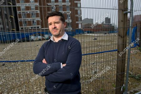 Martin Costello with the building site for the new art gallery.