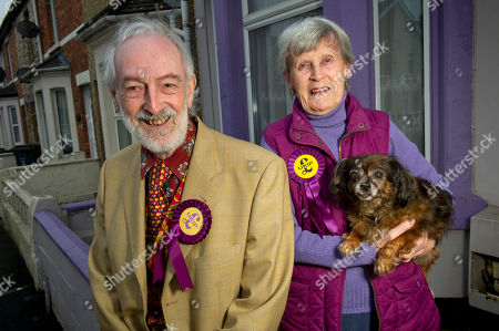 Stock Image of Martin Costello, Aubrey & Sheila Attwater in front of their purple painted house .